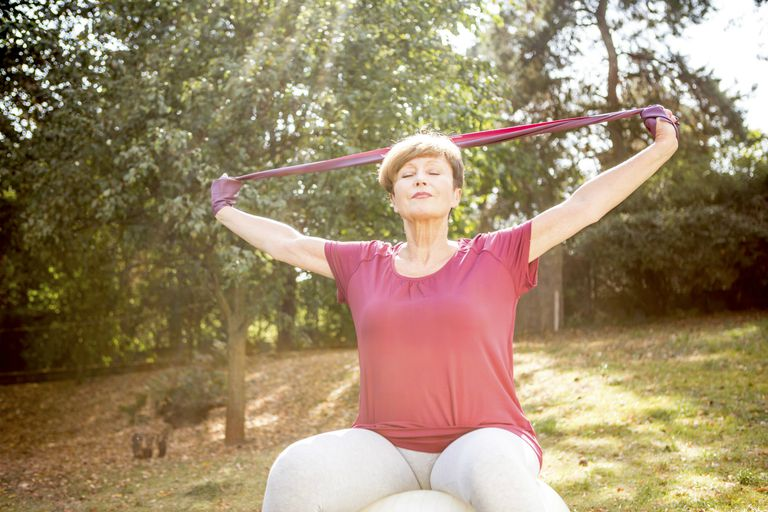 Older woman using resistance band