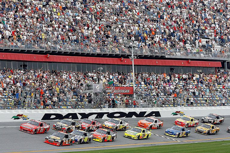 DAYTONA BEACH, FL - FEBRUARY 12: Martin Truex, Jr., driver of the #1 Bass Pro Shops/Tracker Boats Chevrolet, leads the field to the green flag to start the NASCAR Sprint Cup Series Gatorade Duel 1 at Daytona International Speedway on February 12, 2009 in Daytona Beach, Florida.