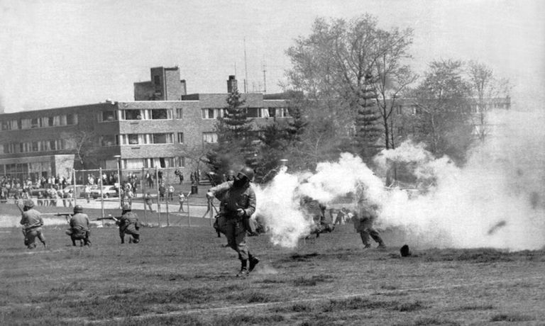 National Guard troops throwing tear gas at protesting Kent State students on May 4, 1970.