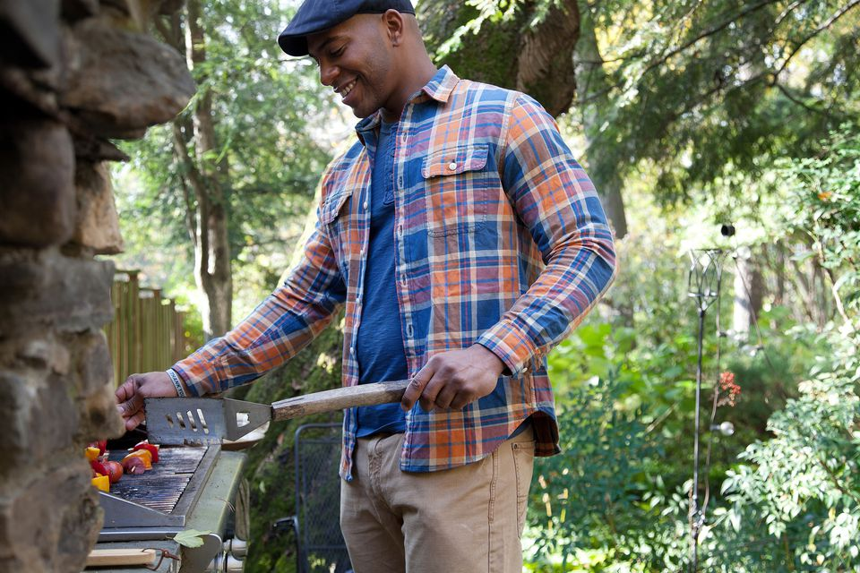 man grills outdoors