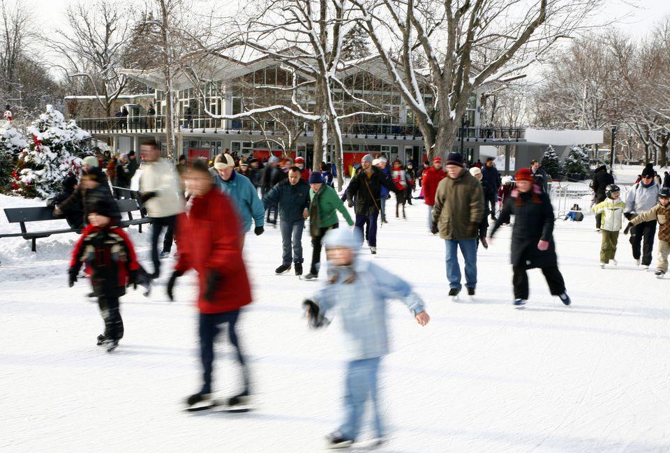 People ice-skating on Beaver Lake (Lac aux Castors), Parc du Mont Royal.