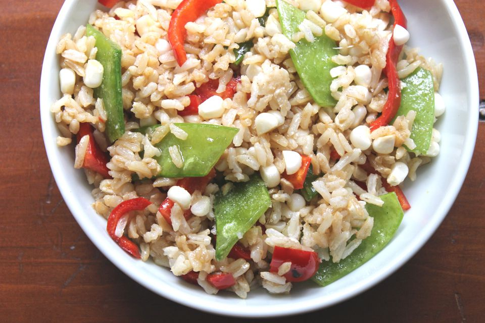 Vegetarian and vegan Asian brown rice salad with snow peas and bell peppers