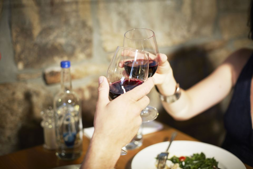 Couple toasting with wine at restaurant
