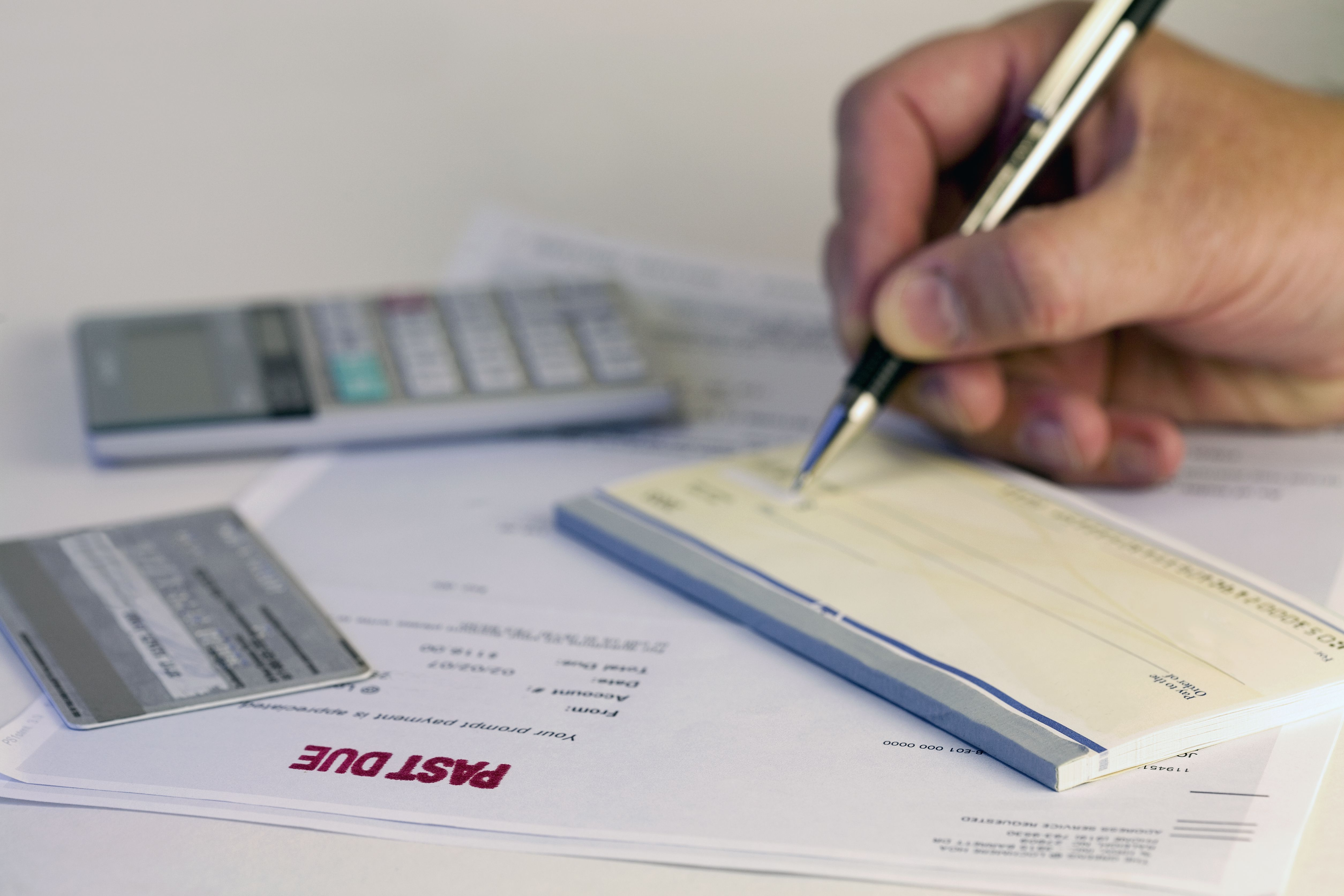 From paper check to electronic payment a man writing a check for ccuart Choice Image