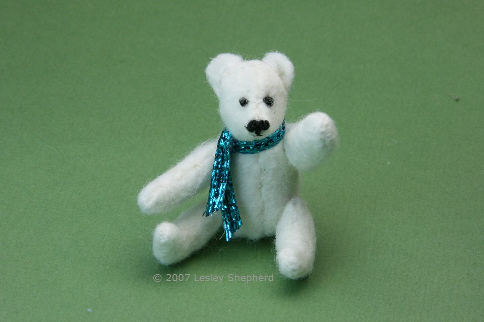 White jointed miniature polar bear, 2.5 inches high, made from felt
