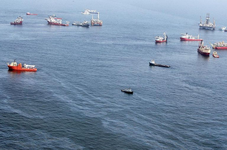 Oil sheen is seen with vessels assisting near the source of the BP Deepwater Horizon oil spill on July 18, 2010 in the Gulf of Mexico