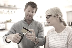A couple cuts up a credit card