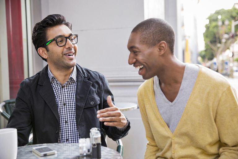 Men talking at sidewalk cafe
