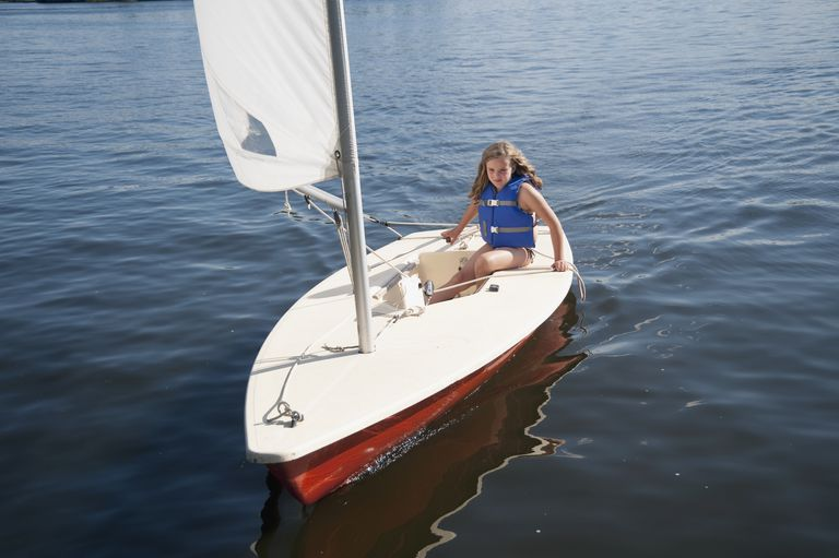 Girl In Small Sailboat