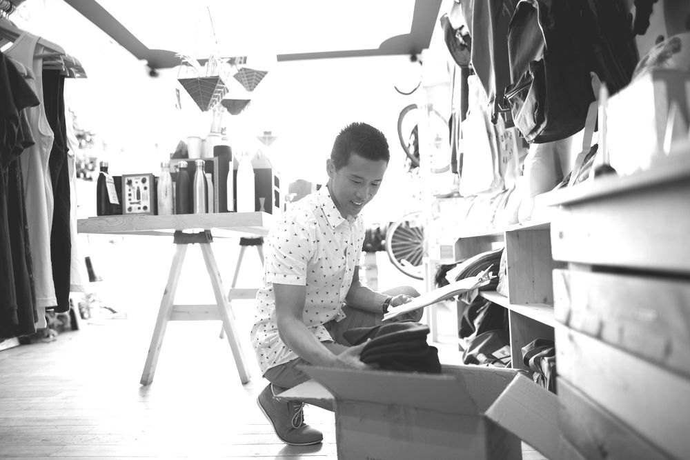 Man in retail store unboxing clothes
