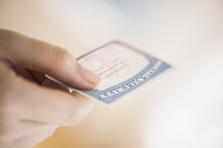 Close up of woman's hand holding social security card