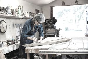 Woman working in wood shop