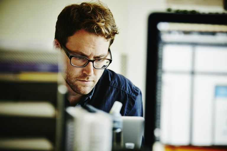 Businessman working on laptop in startup office