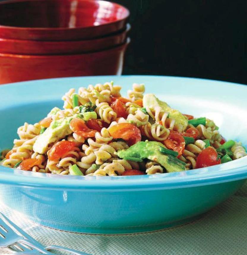 Whole wheat pasta salad with avocado and fresh basil