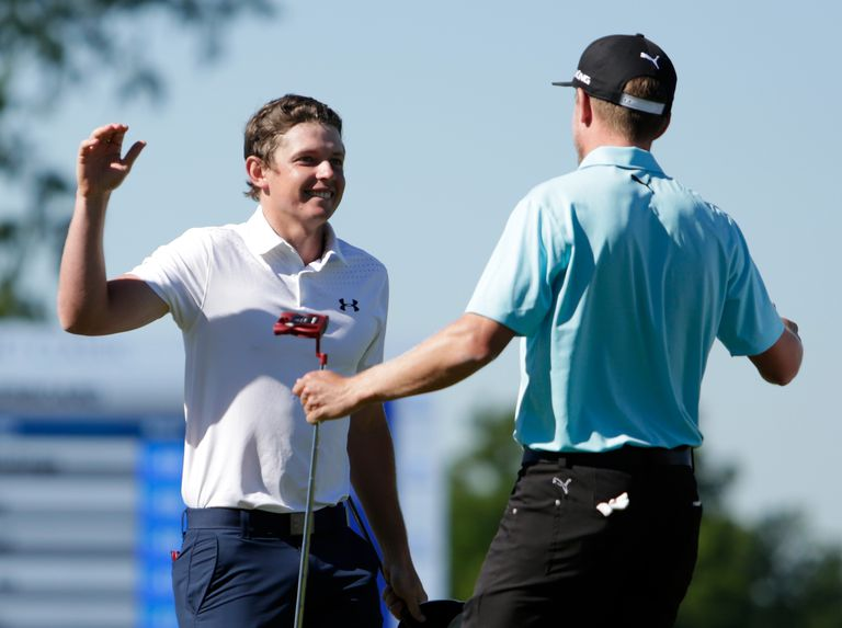 Cameron Smith of Australia and Jonas Blixt of Sweden react after putting in to win in a sudden-death playoff during a continuation of the final round of the Zurich Classic at TPC Louisiana on May 1, 2017 in Avondale, Louisiana.