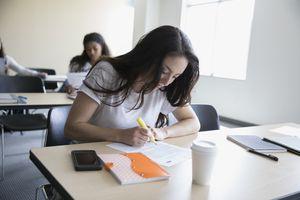 Woman highlighting document