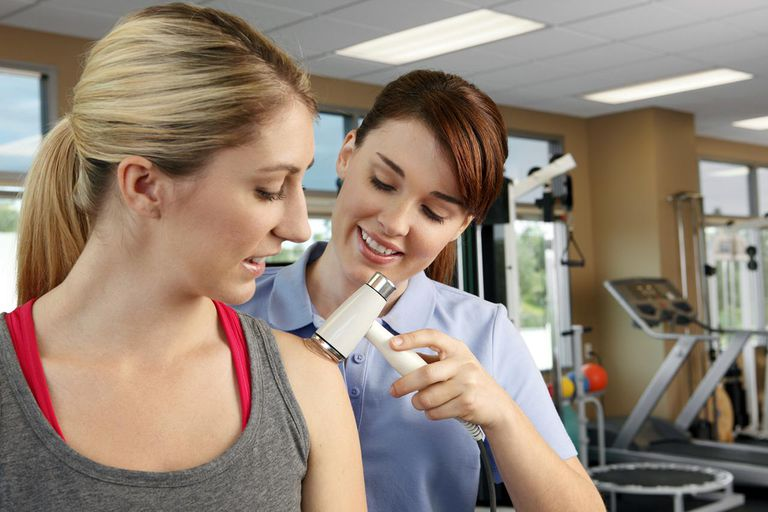 A physical therapist administering an ultrasound on a young woman's shoulder.To see more physical therapy images click on the link below: