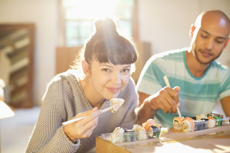 Couple eating sushi together