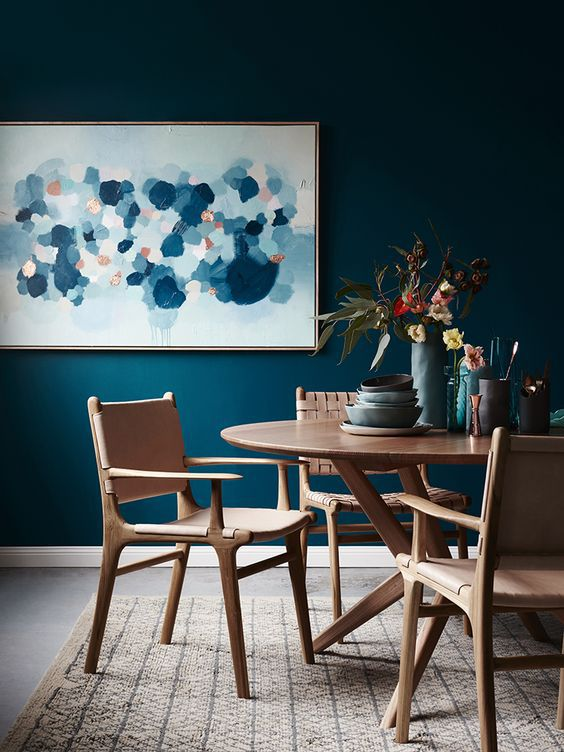 Wooden furniture and blue walls