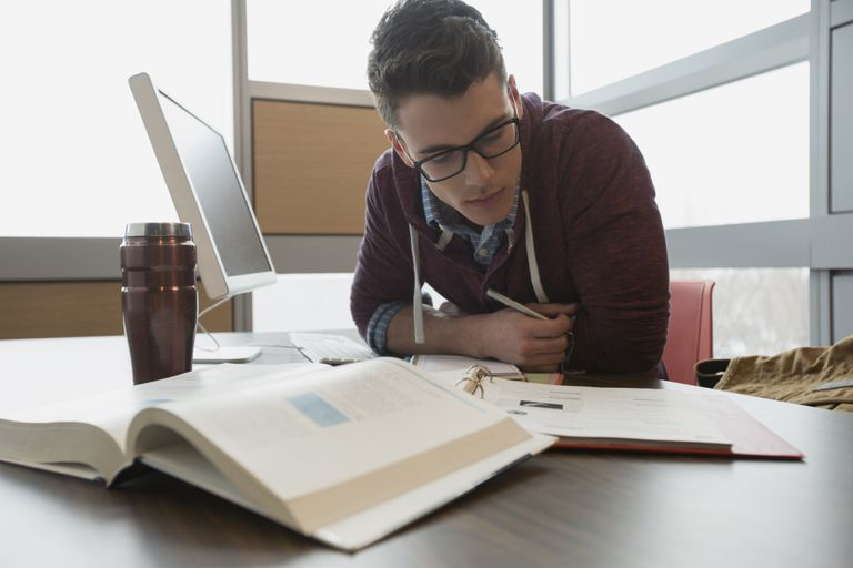 man studying at a desk