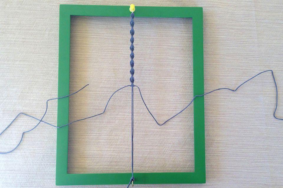 Homemade macrame tying board
