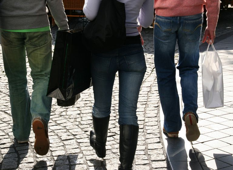 Teens walking with shopping bags