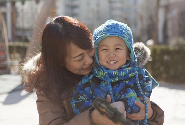 Mother and boy playing outdoor