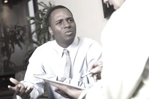 young business person looking perplexed