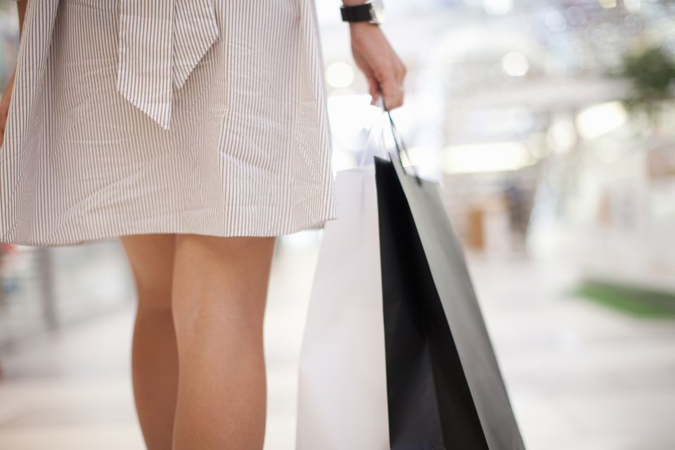 Backview of young woman with shopping bag