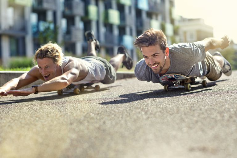 Two boys on skateboards