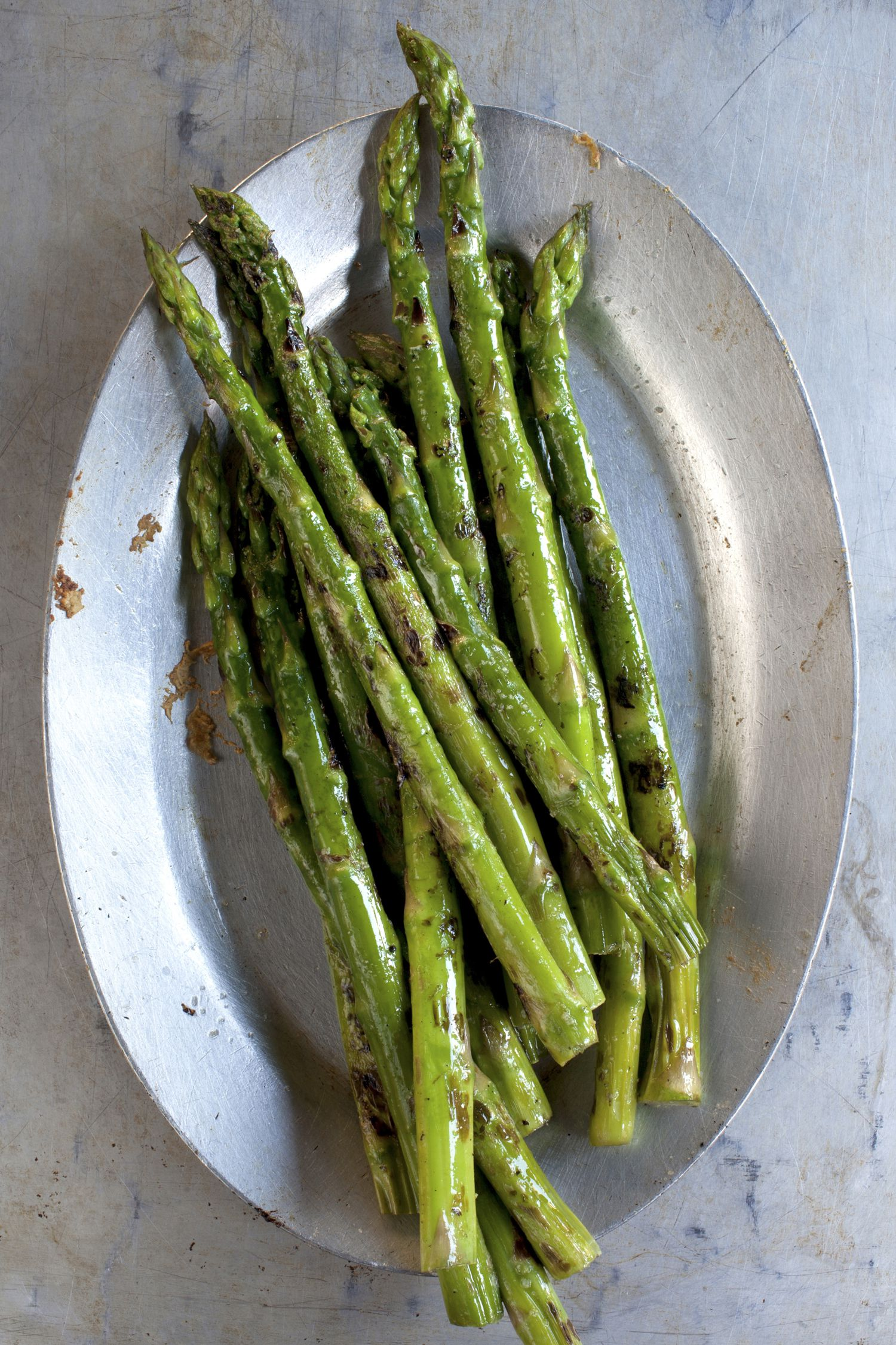 Asparagus nutrition facts calories and health benefits close up of plate of grilled asparagus ccuart Gallery