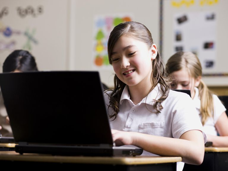 Girl with laptop in classroom