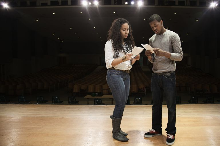 Students rehearsing onstage