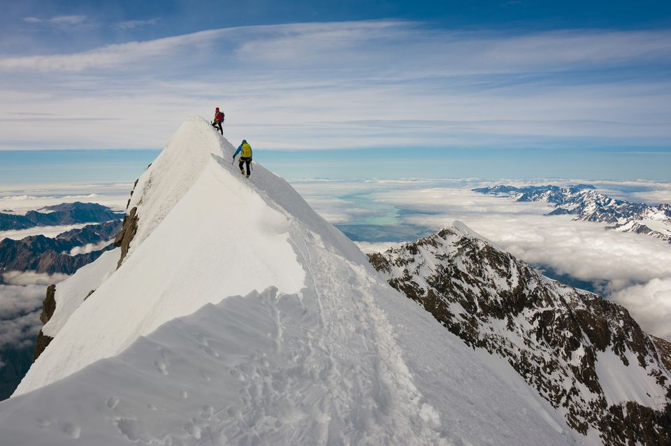One Climber Belays Another To The Corniced Summit Of Aoraki