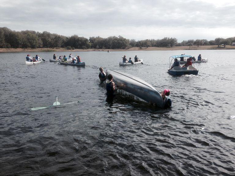 Youth Flip a Canoe