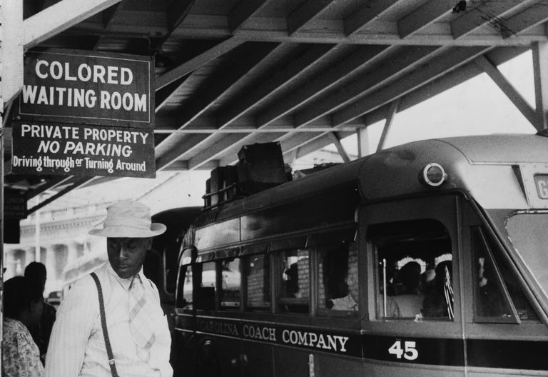 Photograph of sign for colored waiting room in Jim Crow era.