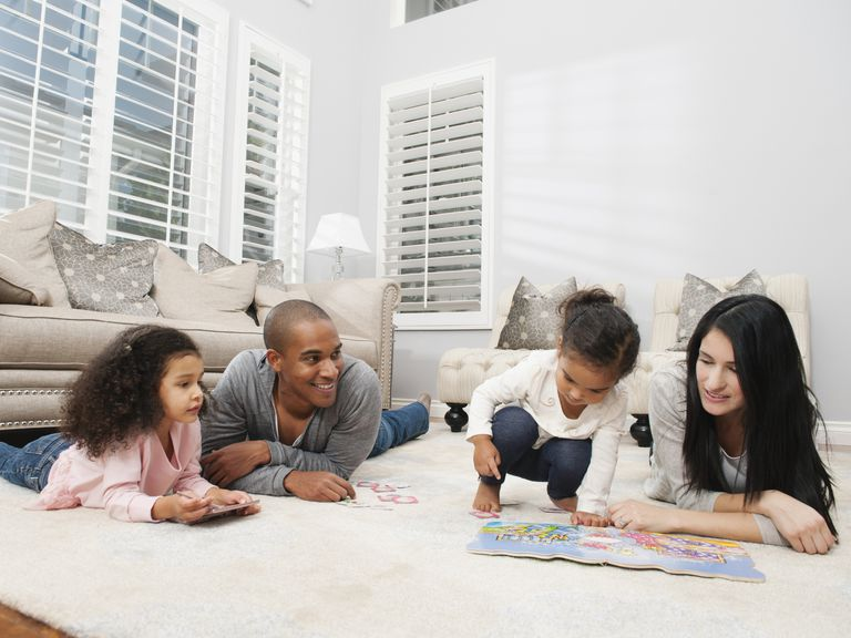 family game night - family playing board games for kids on floor