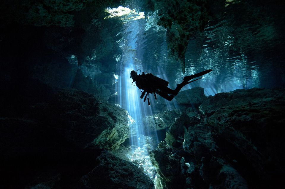 Scuba diver inside cenote in Mexico