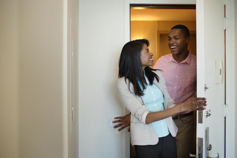 Couple Walking Into an Apartment Together