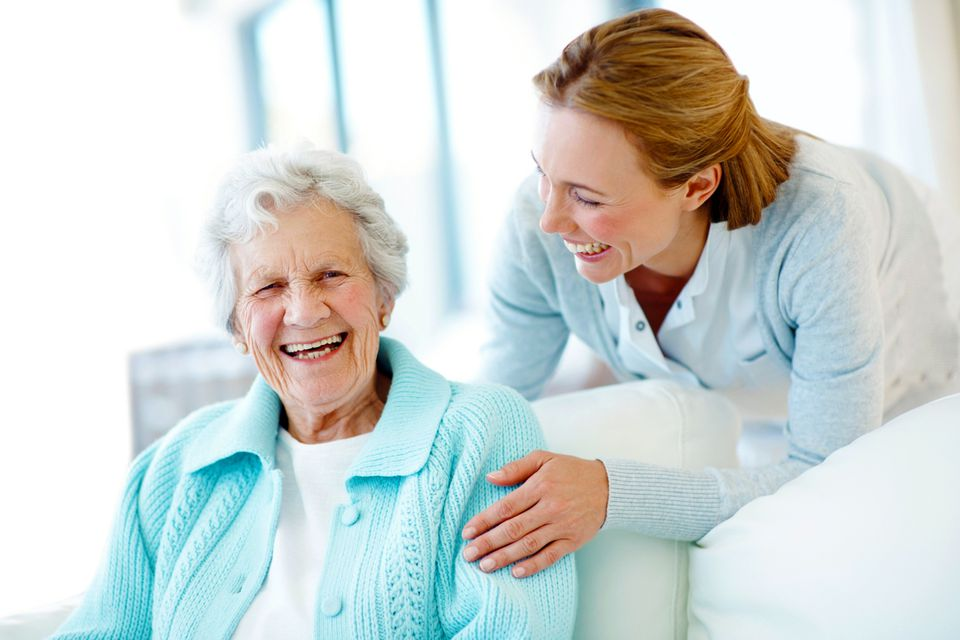 Woman laughing with senior woman