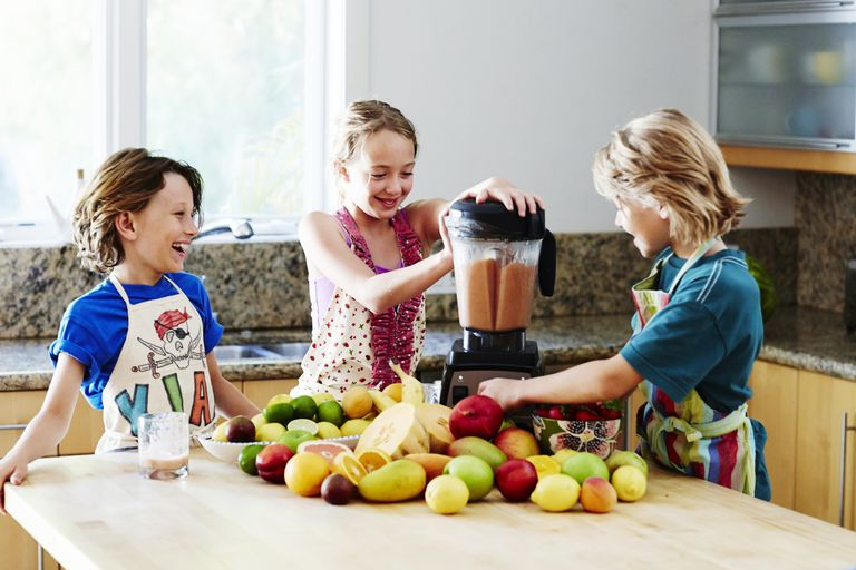 Immune system health - Kids making smoothie with fruit