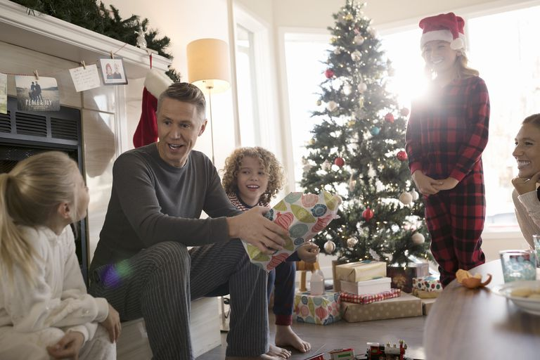 Family opening Christmas gifts