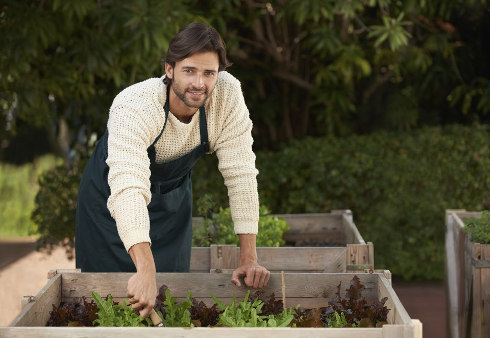 man working in garden bed