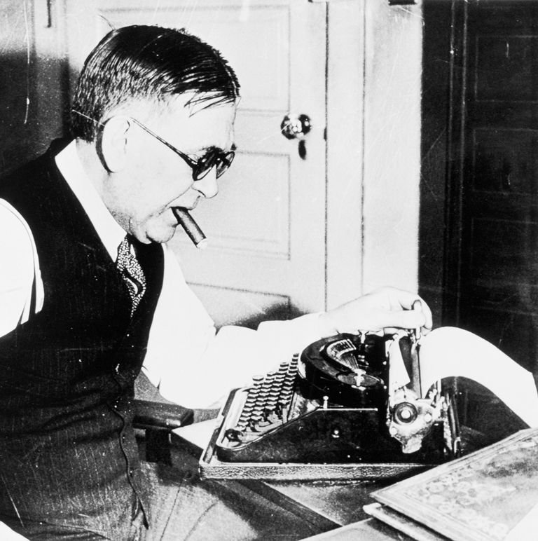 H. L. Mencken Working With Cigar in His Mouth