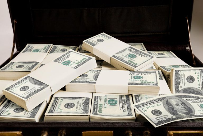 Open briefcase with money inside