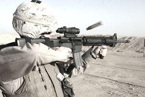 U.S. Marine firing an M16A4 equipped with an ACOG.