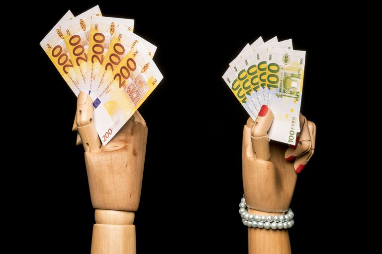 Man's hand and a woman's hand waving money
