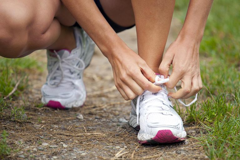 woman tying sports shoelace