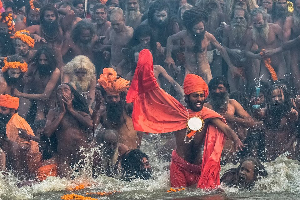 photo essay evocative pictures of the kumbh mela a crowd of naga sadhus bathing at the kumbh mela
