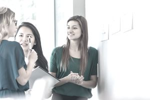 Diverse young businesswomen working on creative project in office